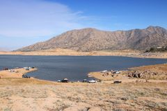 Low level lake. Drought in California - low level of Lake Isabella in Kern County. United States landscape stock images