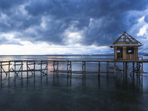 Low light long exposure landscape shot. A chalet on the water is being constructed Stock Photography