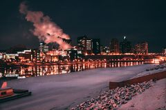 Low Light Photo of Lighted Buildings in Front of Body of Water Royalty Free Stock Photo