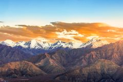 Low light scenery of sunset over the snow mountain Royalty Free Stock Photos