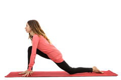 Low lunge pose. Caucasian yogi woman doing low lunge during exercise. Isolated on white background royalty free stock photos