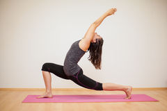 Low lunge in a yoga studio Royalty Free Stock Photo