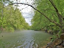 Misty Water over Smith River. A low lying fog hangs above the water of Smith River below Philpott Dam Virginia royalty free stock image