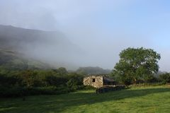 Low mist rolling up cadair idris valley in snowdonia national park Stock Photos