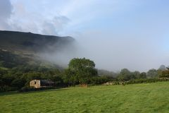 Low mist rolling up cadair idris valley in snowdonia national park Stock Image