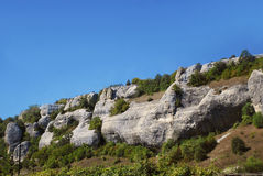 Low mountain range in the central Crimea. Low mountain range against the blue sky in the central Crimea Stock Image