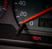 Low Oil. Sign in a car that is lit red Royalty Free Stock Images