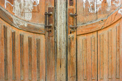 Low part of a brown wood weathered door with two Royalty Free Stock Images