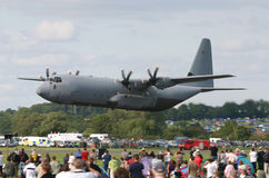 Low pass at airshow. C130 Hercules makes a low pass at high speed Royalty Free Stock Photos