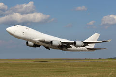 Low pass of big white plane Stock Photography