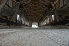 Low Perspective. A covered bridge vanishing point perspective Stock Image