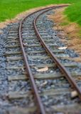 Narrow guage railroad tracks in Agnew Park, Stranraer, Scotland, United Kingdom. Low perspective image of narrow guage railroad tracks for a children`s train in royalty free stock photography