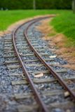 Narrow guage railroad tracks in Agnew Park, Stranraer, Scotland, United Kingdom. Low perspective image of narrow guage railroad tracks for a children`s train in royalty free stock images