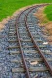Narrow guage railroad tracks in Agnew Park, Stranraer, Scotland, United Kingdom. Low perspective image of narrow guage railroad tracks for a children`s train in stock photos
