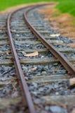 Narrow guage railroad tracks in Agnew Park, Stranraer, Scotland, United Kingdom. Low perspective image of narrow guage railroad tracks for a children`s train in royalty free stock photo