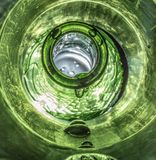 Low Perspective Macro Shot on Dripping Wet Bottle royalty free stock image