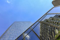 Low perspective photo of skyscraper and mirror reflections in the glass. In Charlotte, North Carolina Stock Photos