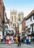 Low Petergate, a thriving street in York, England. Low Petergate a thriving street for shopping and dining in the city of York that is overlooked by York royalty free stock images