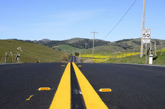 Center road markings. Low point of view of the center road markings Royalty Free Stock Images