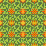 Low poly flower pattern. Abstract geometric vector seamless background in green and orange tones Royalty Free Stock Photos