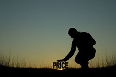 Low price concept. Low price. Man holding his hand on the PRICE word, meaning low prices Stock Photography