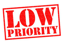 LOW PRIORITY. Red Rubber Stamp over a white background Royalty Free Stock Images
