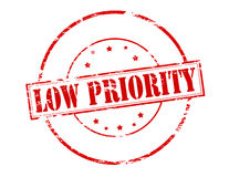 Low priority. Rubber stamp with text low priority inside,  illustration Royalty Free Stock Image