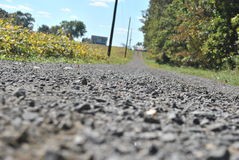 Low profile gravel road Stock Photography