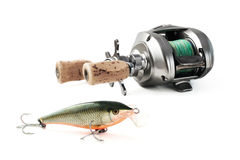Low-proflile casting reel with lure Royalty Free Stock Photo