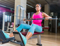 Low pulley rows woman wide grip seated girl. Workout gym exercise royalty free stock photo