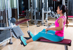 Low pulley rows woman wide grip seated girl. Workout gym exercise Royalty Free Stock Photos