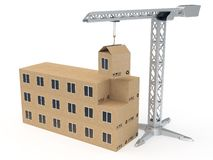Low quality construction concept. Tower crane building a house from cardboard boxes rendered with soft shadows on white background Royalty Free Stock Photo