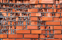 Low quality facing bricks. Red brick wall destroyed by frozen wa Stock Images