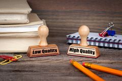 Low quality and high quality. Rubber Stamp on desk in the Office. Business and work background Royalty Free Stock Images