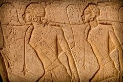 Low-relief, Abu-Simbel. Scenes of nubian prisoners in low-relief at the entrance of the Abu-Simbel Temple (Egypt Royalty Free Stock Photography