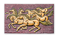 Low relief cement Thai style handcraft of horse on wall. Royalty Free Stock Photography