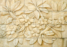 Low relief cement Thai style handcraft of plumeria or frangipani Stock Photography