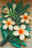 Low relief cement Thai style handcraft of plumeria or frangipani flowers Stock Image