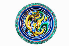 Low relief engraving image of dragon tale isolated on white from. Chinese temple in Thailand royalty free stock photography
