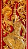 Low Relief on the front door of Wat Bovorn (Bowon) Nivet Viharn in Bangkok Stock Images