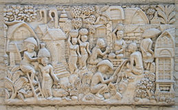 Low relief representing life of ancient thai village Royalty Free Stock Photo