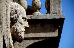 Low relief on wall of Verona, Italy. Low relief stone carving of male sage face on exterior wall in Verona, Italy against blue skies on sunny day stock photos