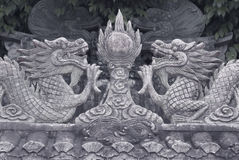 The low-relief stone dragons in Chinese style Royalty Free Stock Photo