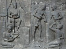 Low relief of Thai ancient people, Sukhothai, Thailand. Low relief of Thai ancient people, King Ramkhamhaeng the Great and his soldier was making stone royalty free stock photo