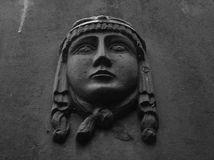 A low relief of a woman face on the stone Stock Photo