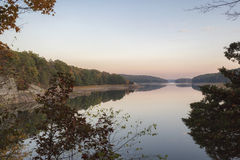 Low Reservoir, at Sunset. Water levels are greatly diminished in the Redding reservoir in Connecticut this year.  Steep embankments at its edges testify to Stock Photos