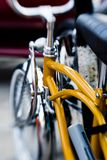 Low-rider cruising bicycle. Low-rider cruising locked up by the beach, with new and chrome Royalty Free Stock Photo