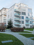 Low Rise Apartment Building near Park with Paths Royalty Free Stock Images