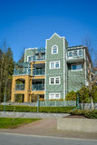 Low rise residential building on blue sky background. Winter season in Vancouver stock photo