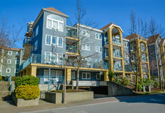 Low rise residential buildings on blue sky background. Low rise residential building on blue sky background. Vancouver on winter season Royalty Free Stock Photo